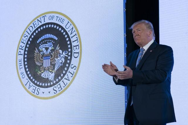 Trump-unknowingly-stood-in-front-of-symbol-with-Russia-golf-imagery